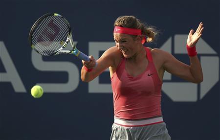 Victoria Azarenka of Belarus hits a return to Aleksandra Wozniak of Canada at the U.S. Open tennis championships in New York August 29, 2013. REUTERS/Adam Hunger