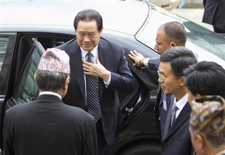 China's Politburo Standing Committee Member Zhou Yongkang (L) arrives for a meeting with Nepal's caretaker Prime Minister Jhala Nath Khanal (not pictured) at the Prime Minister's Office at Singha Durbar in Kathmandu August 17, 2011.REUTERS/Navesh Chitrakar