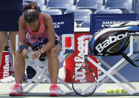 Sara Errani of Italy sits during a break in play against compatriot Flavia Pennetta at the U.S. Open tennis championships in New York August 29, 2013. REUTERS/Mike Segar