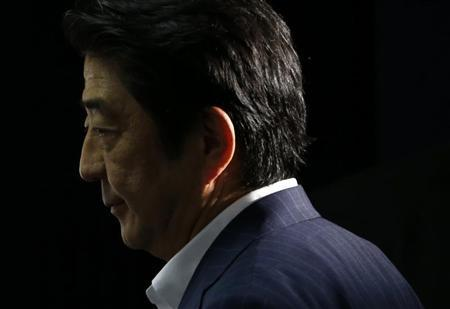 Japan's Prime Minister Shinzo Abe, and the leader of the ruling Liberal Democratic Party (LDP), makes an appearance before media at the LDP headquarters in Tokyo July 21, 2013, after an upper house election. REUTERS/Issei Kato