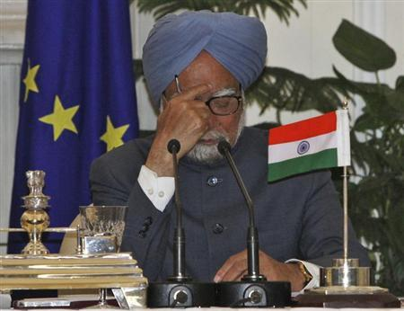 Prime Minister Manmohan Singh attends a joint news conference with European Commission President Jose Manuel Barroso and European Council President Herman Van Rompuy at the EU-India summit in New Delhi February 10, 2012. REUTERS/B Mathur/Files