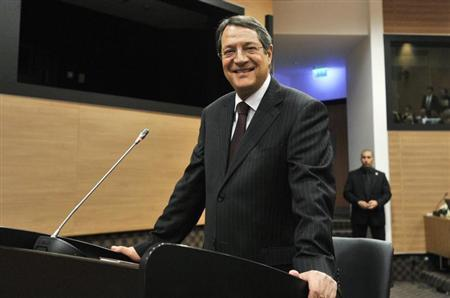 Cypriot President Nicos Anastasiades smiles before testifying to a judicial panel in Nicosia August 27, 2013. REUTERS/Yiannis Nisiotis