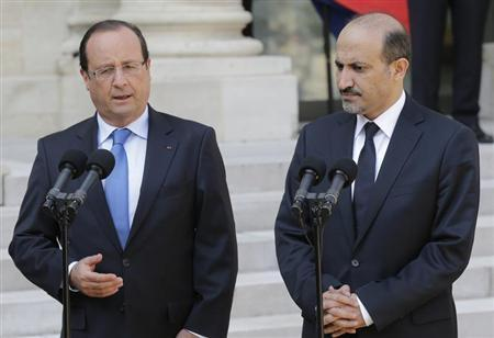 French President Francois Hollande and Ahmad Jarba (R), head of the opposition Syrian National Coalition, speak to journalists in the courtyard of the Elysee Palace in Paris, August 29, 2013. REUTERS/Jacky Naegelen