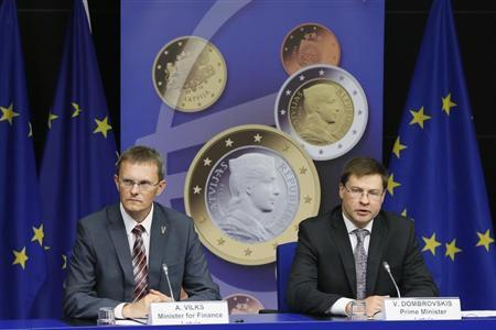 Latvia's Prime Minister Valdis Dombrovskis and Finance Minister Andris Vilks (L) address a news conference on the adoption of the euro by Latvia at the European Union council building in Brussels July 9, 2013. REUTERS/Francois Lenoir