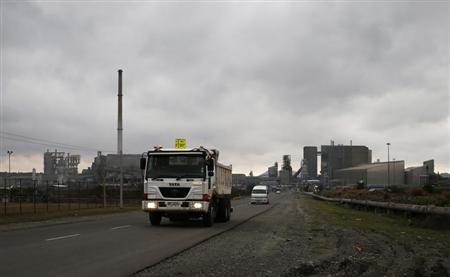 Trucks leave an Anglo American Platinum (AMPLATS) processing plant near Rustenburg in this October 12, 2012 file photo. REUTERS/Mike Hutchings/Files