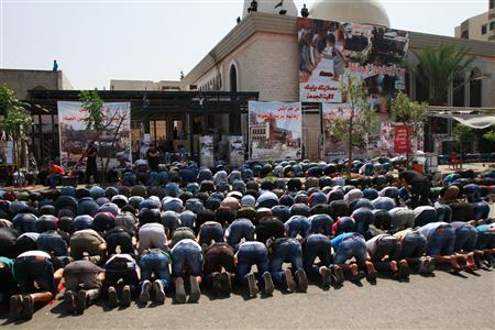 Sunni Muslims attend Friday prayers at the Taqwa mosque, one of two mosques that were hit by explosions last Friday in Lebanon's northern city of Tripoli August 30, 2013. REUTERS/Omar Ibrahim
