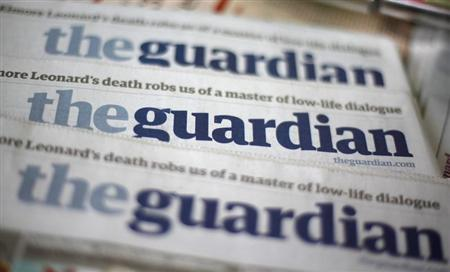 Copies of the Guardian newspaper are displayed at a news agent in London August 21 2013. REUTERS/Suzanne Plunkett