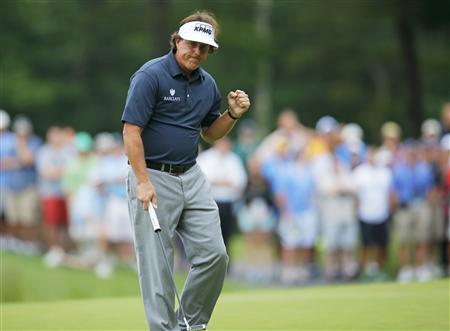 Phil Mickelson of the U.S. pumps his fist after a birdie on the 14th hole during the first round of the Deutsche Bank Championship in Norton, Massachusetts August 30, 2013. REUTERS/Brian Snyder