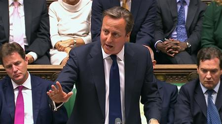 Britain's Prime Minister David Cameron is seen addressing the House of Commons in this still image taken from video in London August 29, 2013. REUTERS/UK Parliament via Reuters TV