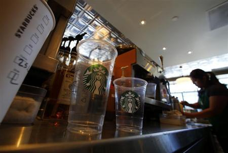 A barista pours a drink at a newly designed Starbucks coffee shop in Fountain Valley, California August 22, 2013. REUTERS/Mike Blake
