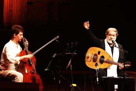 Lebanese composer and singer Marcel Khalife performs with cello player Sari Khalife during the Baalbek festival, which was held in La Magnanerie, a 19th century silk factory, in Beirut August 24, 2013. REUTERS/Jamal Saidi