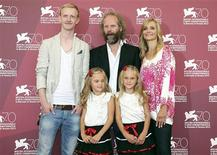 "Director Philip Groning (C top) poses with actors David Zimmerschied (L), Alexandra Finder (R), Pia Kleemann (L bottom) and Chiara Kleemann (R bottom) during a photocall for the movie ""The Police Officer's Wife"" during the 70th Venice Film Festival in Venice August 30, 2013. REUTERS/Alessandro Bianchi"