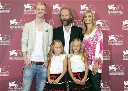 Director Philip Groning (C top) poses with actors David Zimmerschied (L), Alexandra Finder (R), Pia Kleemann (L bottom) and Chiara Kleemann (R bottom) during a photocall for the movie ''The Police Officer's Wife'' during the 70th Venice Film Festival in Venice August 30, 2013. REUTERS/Alessandro Bianchi