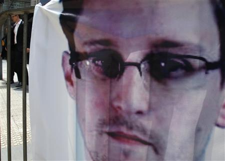 A banner supporting Edward Snowden, a former contractor at the National Security Agency (NSA), is displayed at Hong Kong's financial Central district on June 21, 2013, the day marking Snowden's 30th birthday. REUTERS/Bobby Yip