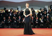 Actress Mia Wasikowska poses during a red carpet at the 70th Venice Film Festival in Venice August 29, 2013. REUTERS/Alessandro Bianchi