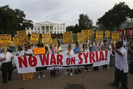 The ''Act now to stop war and end racism'' (ANSWER) coalition holds a rally outside the White House in Washington, August 29, 2013. The group rallied their opposition to U.S.-led military action on Syria. REUTERS/Jason Reed