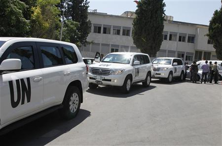 U.N. vehicles, carrying United Nations chemical weapons experts, arrive at Yousef al-Azma military hospital in Damascus August 30, 2013. REUTERS/Khaled al-Hariri