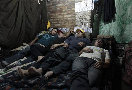 (From L to R) Route 30 public bus drivers Oscar Romero, Simeon Rojas, Dario Peralta and Carlos Silva take part in a hunger strike in protest over their dismissal in Luque, on the outskirts of Asuncion, August 30, 2013. REUTERS/Jorge Adorno