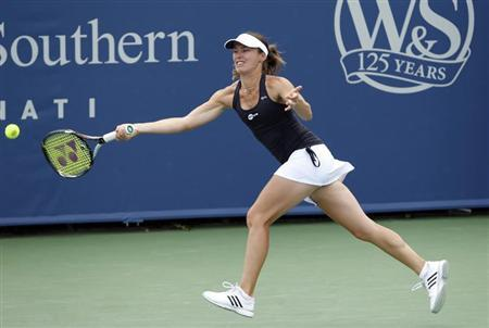 Martina Hingis of Switzerland hits a return during her first round women's doubles match with Daniela Hantuchova of Slovakia against Flavia Pennetta of Italy and Anabel Medina Garrigues of Spain at the Cincinnati Open tennis tournament in Cincinnati, Ohio August 12, 2013. REUTERS/John Sommers II