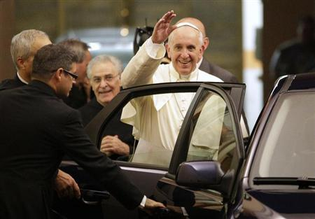 Pope Francis waves as he leaves following a private visit at the Saint Agostino church in Rome August 28, 2013. REUTERS/Max Rossi