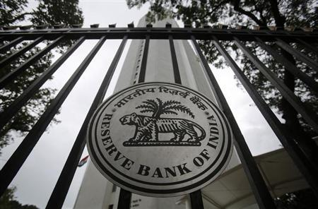 The Reserve Bank of India (RBI) seal is pictured on a gate outside the RBI headquarters in Mumbai July 30, 2013. REUTERS/Vivek Prakash