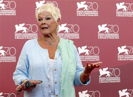 Actress Judi Dench poses during a photocall for the movie ''Philomena'', directed by Stephen Frears, during the 70th Venice Film Festival in Venice August 31, 2013. The movie debuts at the festival. REUTERS/Alessandro Bianchi
