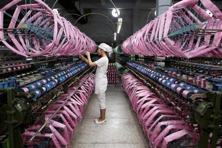 An employee works inside a silk factory in Neijiang, Sichuan province, July 3, 2013. REUTERS/China Daily