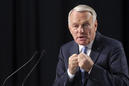 France's Prime Minister Jean-Marc Ayrault delivers a speech at the end the Socialist Party's ''Universite d'ete'' summer meeting in La Rochelle, western France, August 25, 2013. REUTERS/Stephane Mahe