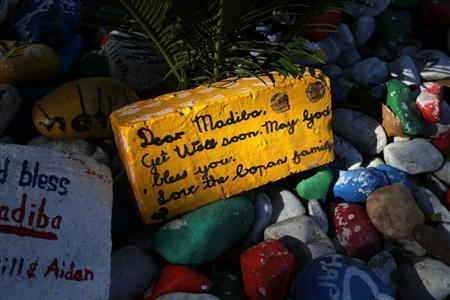 A get-well message is seen on a brick outside former South African president Nelson Mandela's garden in Houghton, Johannesburg August 31, 2013. REUTERS/Siphiwe Sibeko