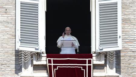 Pope Francis leads his Sunday Angelus prayer in Saint Peter's square at the Vatican September 1, 2013. REUTERS/Tony Gentile