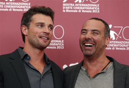 Actor Tom Welling (L) and director Peter Landesman (R) pose during a photocall for their movie ''Parkland'' at the 70th Venice Film Festival in Venice September 1, 2013. REUTERS/Alessandro Bianchi