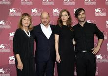 """Director Alexandros Avranas (R) poses with actors Eleni Roussinou (2nd R), Reni Pittaki (L) and Themis Panou during a photocall for their movie """"Miss Violence"""" at the 70th Venice Film Festival in Venice September 1, 2013. REUTERS/Alessandro Bianchi"""
