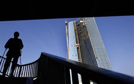 A woman with walking sticks is silhouetted against the sky as she descends steps from a bridge next to the construction site for the new headquarters of the European Central Bank (ECB) in Frankfurt, August 28, 2013. REUTERS/Kai Pfaffenbach