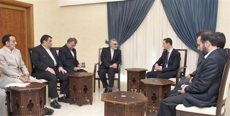 Syria's President Bashar al-Assad (centre-R) meets Alaeddin Boroujerdi, (centre-L) head of the Iranian parliamentary committee for national security and foreign policy, and his delegation, in Damascus September 1, 2013 in this handout released by Syria's national news agency SANA. REUTERS/SANA/Handout via Reuters