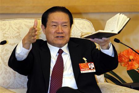 Chinese former Politburo Standing Committee Member Zhou Yongkang gestures as he speaks at a group discussion of Shaanxi Province during the National People's Congress at the Great Hall of the People in Beijing, in this picture taken March 12, 2011. REUTERS/Stringer