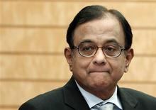 India's Finance Minister Palaniappan Chidambaram waits for the arrival of Japan's Prime Minister Shinzo Abe before their meeting at Abe's official residence in Tokyo in this April 1, 2013 file photo. REUTERS/Issei Kato/Files