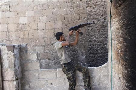 A Free Syrian Army fighter shoots his weapon in the old city of Aleppo, September 1, 2013. REUTERS/Molhem Barakat