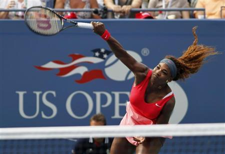 Serena Williams of the U.S. serves to compatriot Sloane Stephens at the U.S. Open tennis championships in New York September 1, 2013. REUTERS/Gary Hershorn