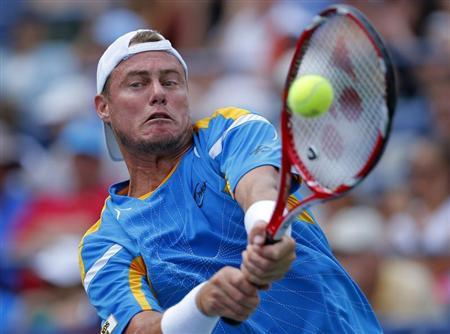 Lleyton Hewitt of Australia hits a return return to Evgeny Donskoy of Russia at the U.S. Open tennis championships in New York September 1, 2013. REUTERS/Kena Betancur