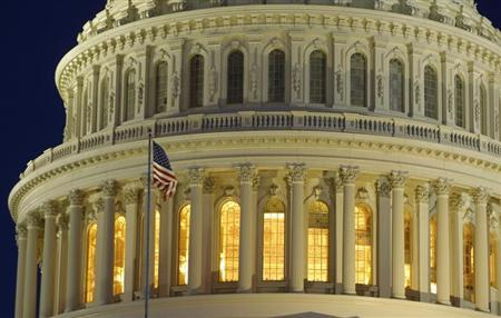 The United States Capitol Dome is seen before dawn in Washington March 22, 2013. REUTERS/Gary Cameron