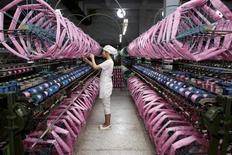 Les résultats définitifs de l'enquête mensuelle Markit-HSBC auprès des directeurs d'achats montrent que l'activité du secteur manufacturier chinois a renoué avec la croissance en août après trois mois de contraction grâce au rebond de la demande intérieure. /Photo prise le 3 juillet 2013/REUTERS/China Daily