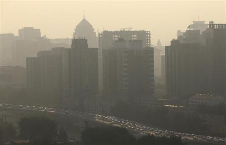 Vehicles past apartment blocks during rush hour in Beijing July 11, 2013. REUTERS/Jason Lee