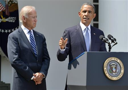 U.S. President Barack Obama speaks next to Vice President Joe Biden (L) at the Rose Garden of the White House August 31, 2013, in Washington. REUTERS/Mike Theiler