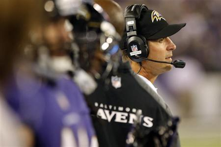 Baltimore Ravens head coach John Harbaugh (R) watches from the sideline during the first half of their NFL pre-season football game against the Atlanta Falcons in Baltimore, Maryland, August 15, 2013. REUTERS/Jonathan Ernst