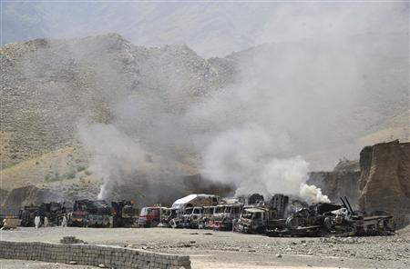 Smoke rises from burning NATO supply trucks after a Taliban attack at Torkham district, in Jalalabad province, September 2, 2013. REUTERS/ Stringer