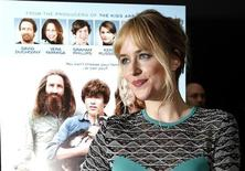 "Cast member Dakota Johnson poses at the premiere of ""Goats"" at the Landmark theatre in Los Angeles, California August 8, 2012. REUTERS/Mario Anzuoni"