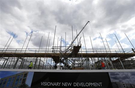 Construction workers stand on scaffolding at a housing development project in south London August 6, 2013. REUTERS/Andrew Winning