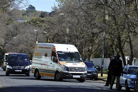 An ambulance, believed to be carrying former South African President Nelson Mandela, arrives at his house in Houghton, Johannesburg September 1, 2013. REUTERS/Stringer