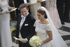 Sweden's Princess Madeleine stands at the altar with U.S.-British banker Christopher O'Neill, at the royal church in the royal castle in Stockholm June 8, 2013. REUTERS/Fredrik Sandberg/Scanpix