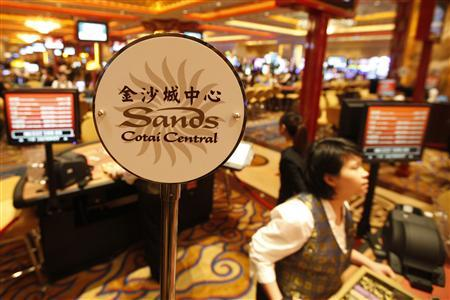 A logo of Sands Cotai Central is seen on a gaming table inside a casino on the opening day of the Sands Cotai Central, Sands' newest integrated resort in Macau April 11, 2012. REUTERS/Tyrone Siu